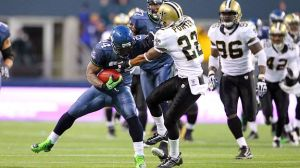 Marshawn-Lynch-stiff-arm-Porter-Saints